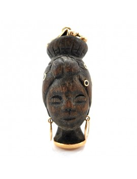 18K WOOD AND GOLD PENDANT....