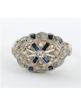 PLATINUM, 18K GOLD, DIAMONDS AND SINTHETIC SAPPHIRE RING