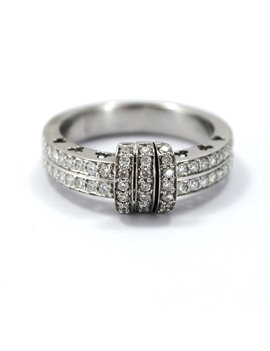 18 kt white RING with two rows of diamonds And central detail of 3 bars with bright with movement