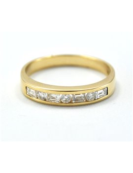 GOLD RING 18KTES WITH 4 BRILLIANT BAGUETTES AND 3 BRILLANT ROUNDS